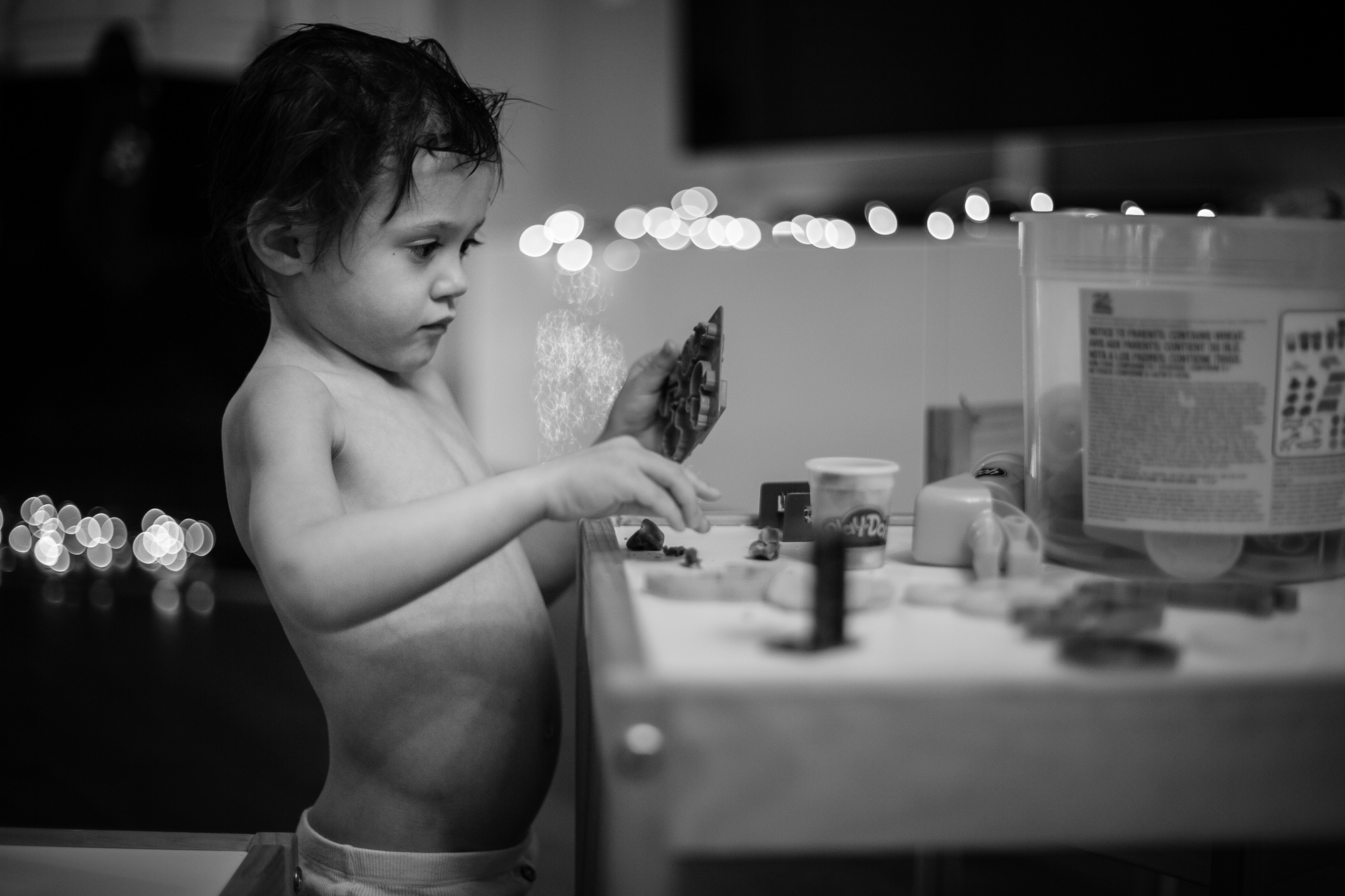 black and white photography, toddler with hasbro play doh