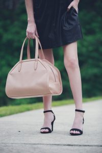 Lifestyle and Fashion Blogger, Jessica Linn, wearing a faux leather Forever21 dress, ASOS heels, a statement necklace from Target, earrings from the Baublebar, and carrying a Matt and Nat purse.
