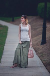 Jessica Linn from the lifestyle and fashion blog Linn Style wearing a green maxi skirt from Target, and tan tank top from Target, Baublebar earrings, a Kendra Scott bracelet, Charming Charlie sunglasses and carrying a Matt and Nat purse. 17 weeks pregnant maternity pregnancy clothes and style.