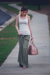 Jessica Linn from the lifestyle and fashion blog Linn Style wearing a green maxi skirt from Target, and tan tank top from Target, Baublebar earrings, a Kendra Scott bracelet, Charming Charlie sunglasses and carrying a Matt and Nat purse. 17 weeks pregnant maternity pregnancy clothes and style. Tory Burch sandals