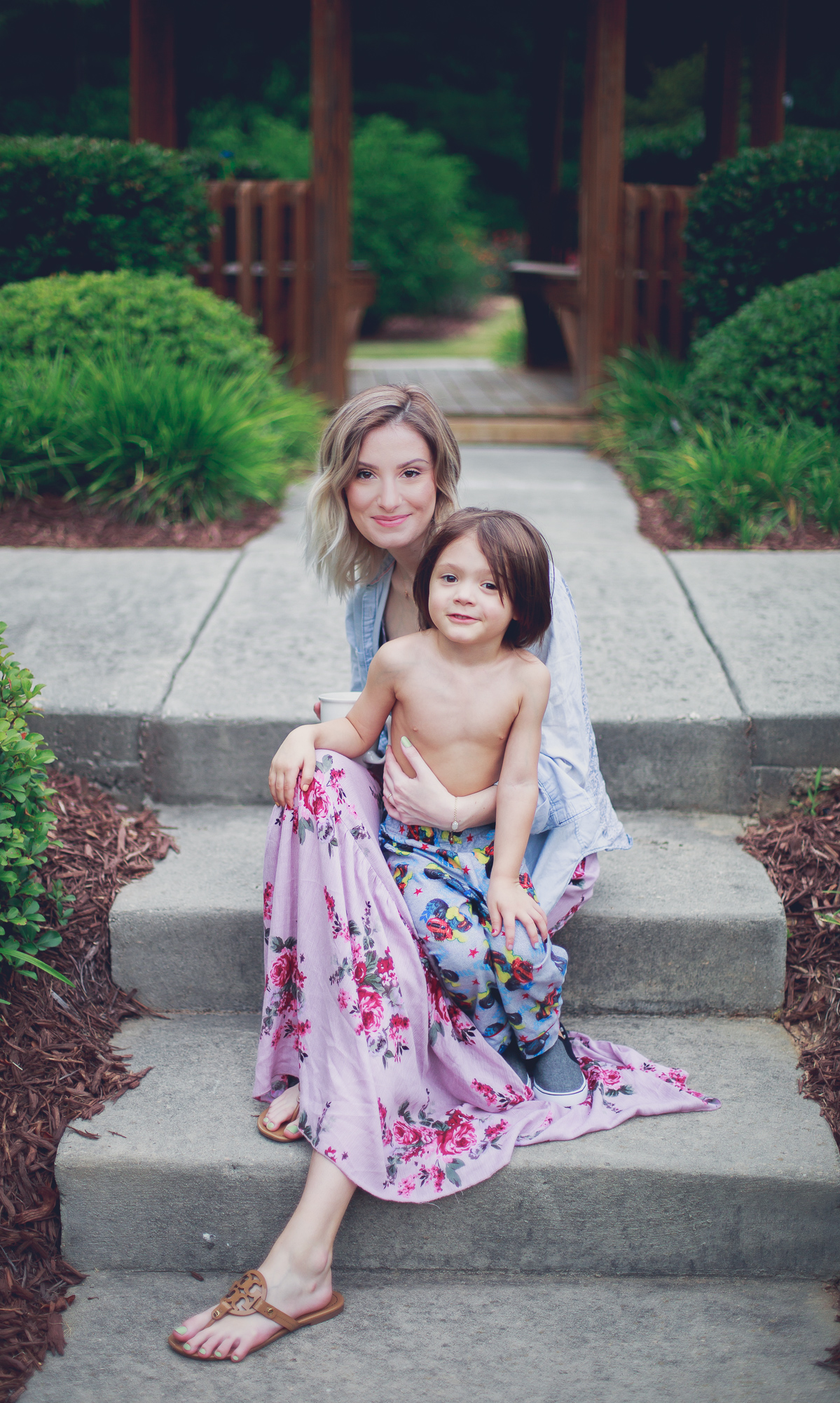 Lifestyle, fashion, and beauty blogger / vlogger Jessica Linn from Linn Style wearing a pink floral maxi skirt from Ross a simple black tank and unbuttoned chambray with Tory Burch Sandals. Maternity Fashion Maternity Style