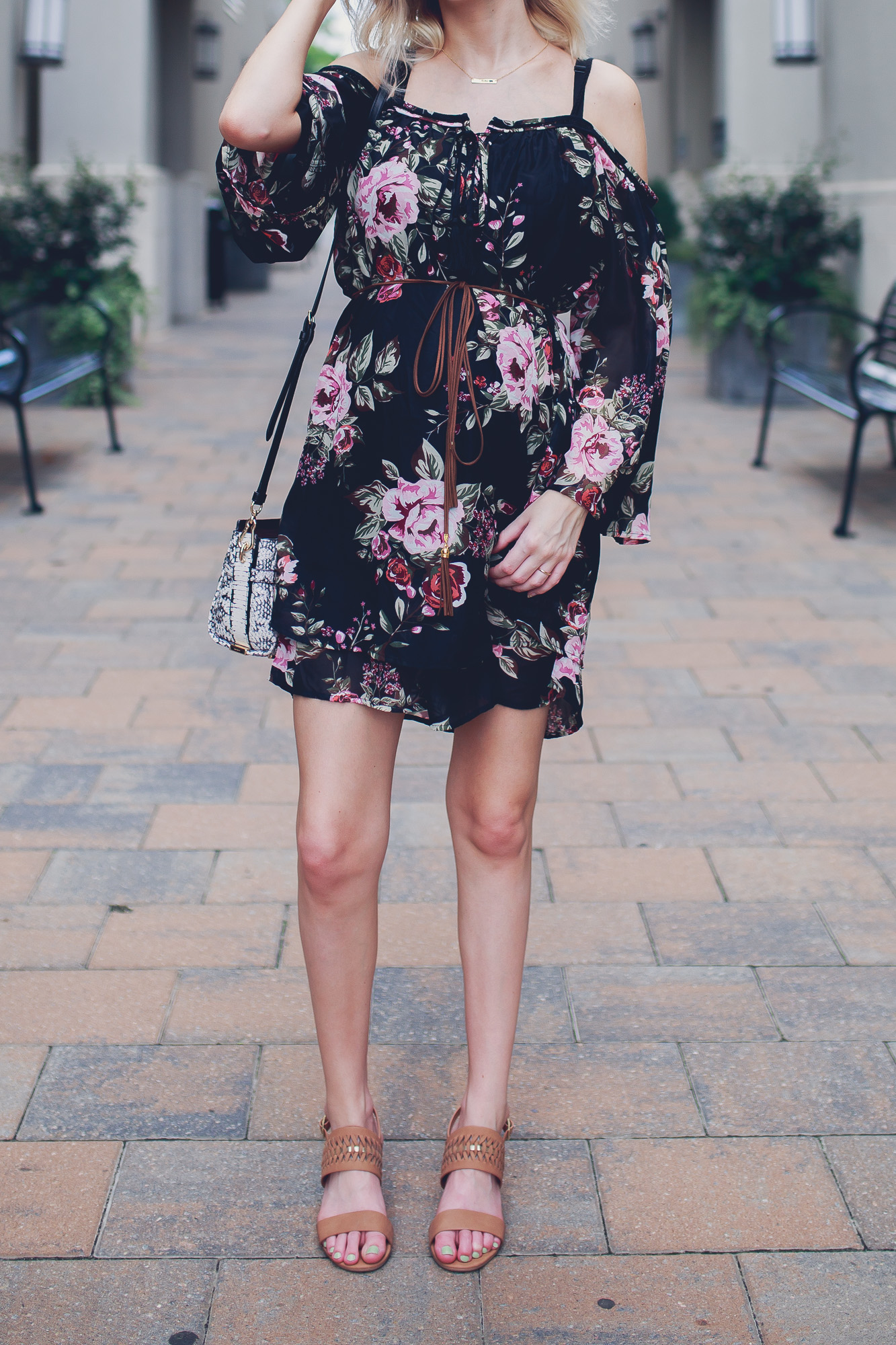 Fashion, lifestyle, and beauty blogger / vlogger Jessica Linn from Linn Style wearing an off the shoulder black floral mid thigh dress with Matisse footwear heels, a coach purse, and a Mamma Bear necklace from CY Design Studio in North Hills Raleigh North Carolina