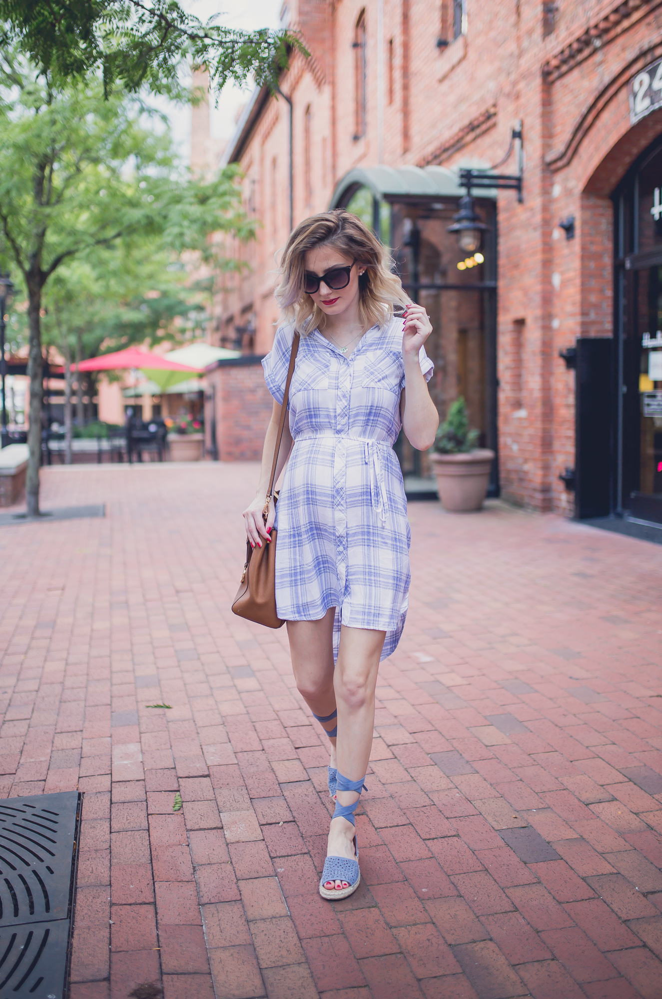 Fashion, lifestyle, and beauty blogger/ vlogger Jessica Linn on Linn Style wearing a summer blue and white plaid button up t-shirt dress from Ross, lace up blue sandals from Report footwear, and jewelry from local Cary North Carolina business CY Design Studio and lipstick from locally made all natural organic lipstick from SumerReign Cosmetics by Ashley Summerville in Durham NC.