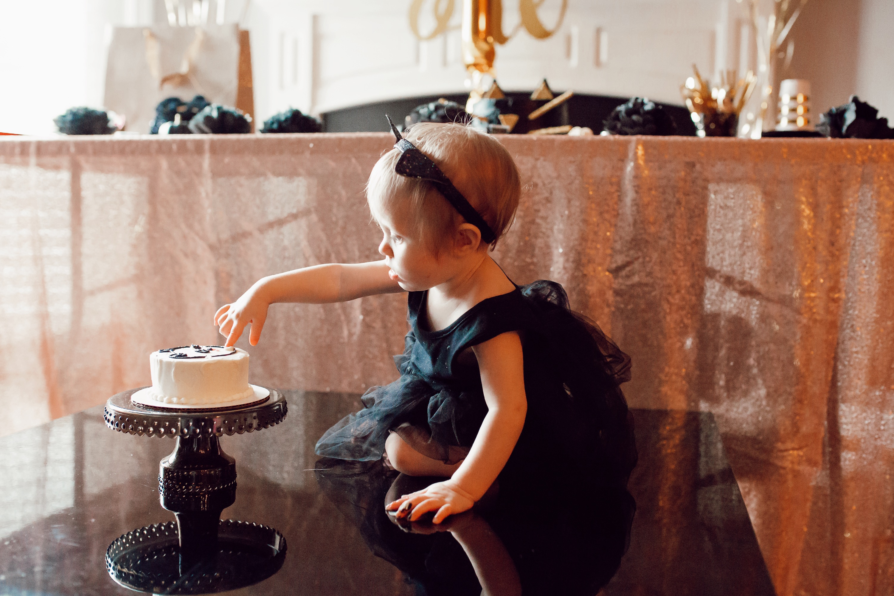 Baby girl first birthday black cat party theme.
