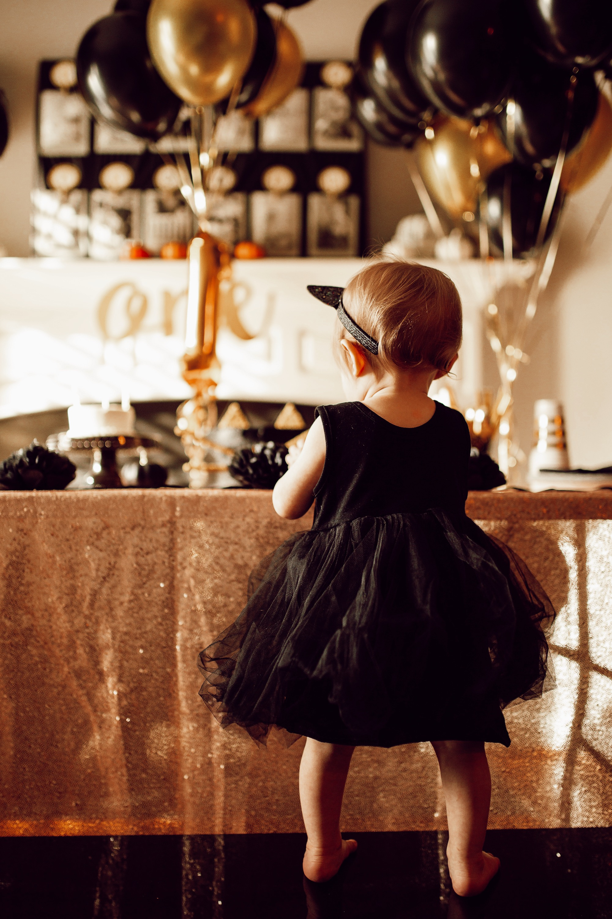 Baby girl first birthday party, black cat themed halloween birthday party.