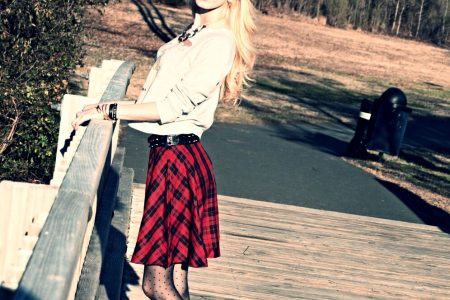 North Carolina fashion, lifestyle, and beauty blogger Jessica Linn wearing a Toy Story sweat shirt and plaid leather studded skirt from Forever21.