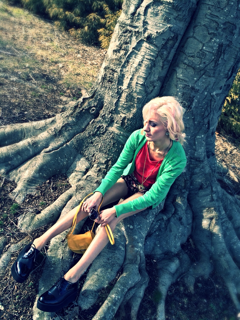 North Carolina fashion and lifestyle blogger Jessica Linn wearing a green cardigan from Target, a pink sweater and floral high-waisted shorts from Forever21, and Steve Madden platform shoes.