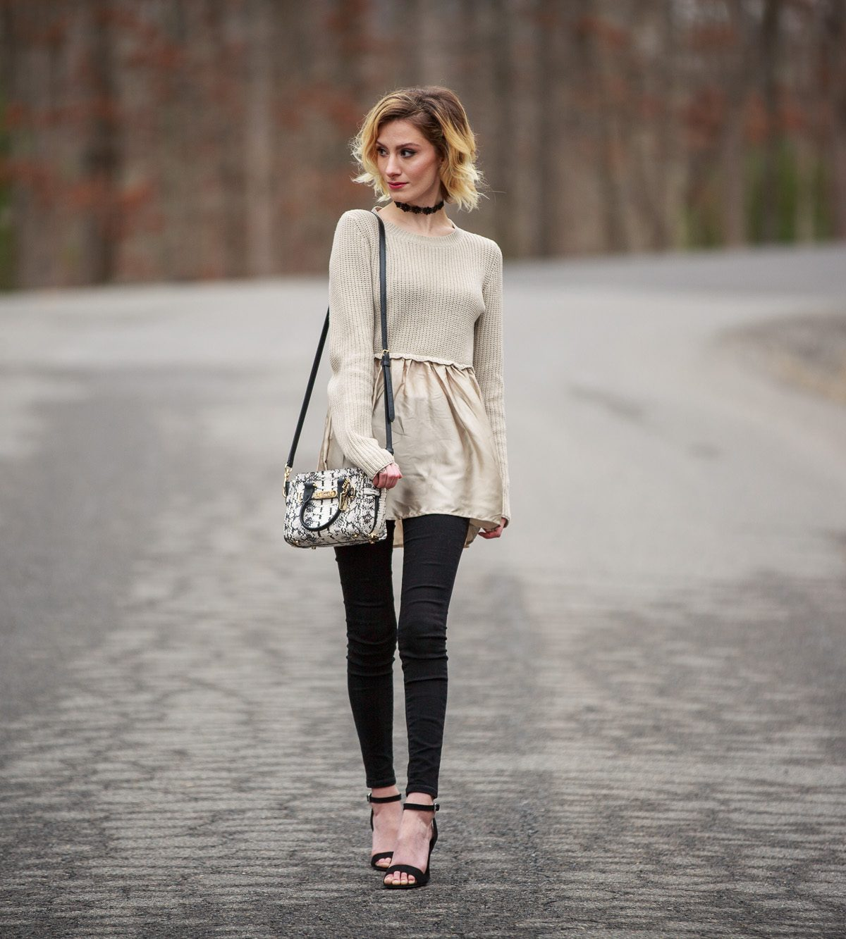 Fashion Blogger Jessica Linn from Linn Style wearing a sweater from Target and black skinny jeans from Old Navy with a pair of ASOS heels and a Coach purse.