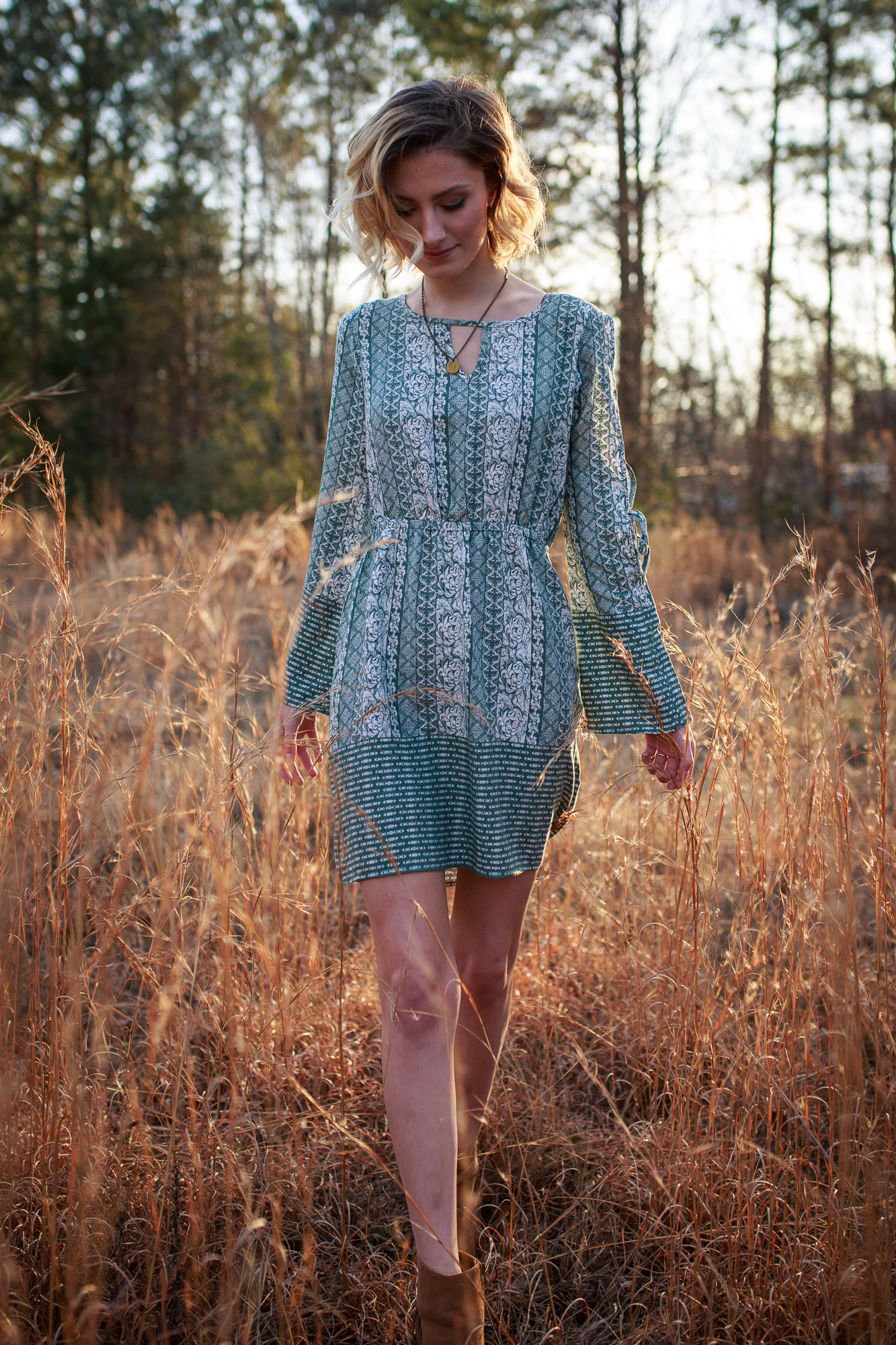 Lifestyle blogger Jessica Linn from Linn Style wearing a green patterned dress from Ross and Forever21 boots