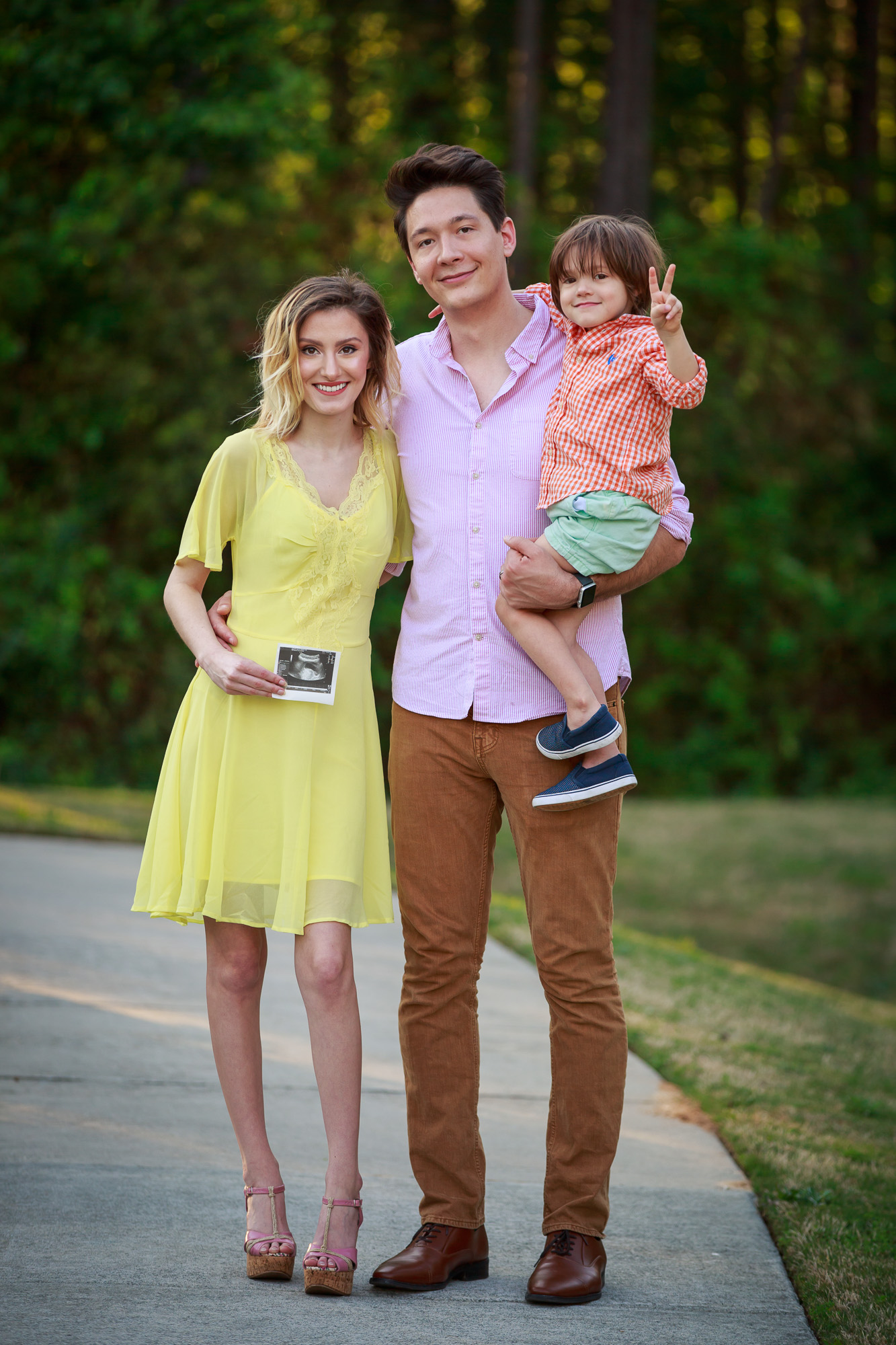 Fashion blogger, Jessica Linn of Linn Style, family photo pregnancy announcement with son and husband Joel Pagan , Jessica Linn is wearing a popular spring trend of pastel yellow and lace dress from ASOS.