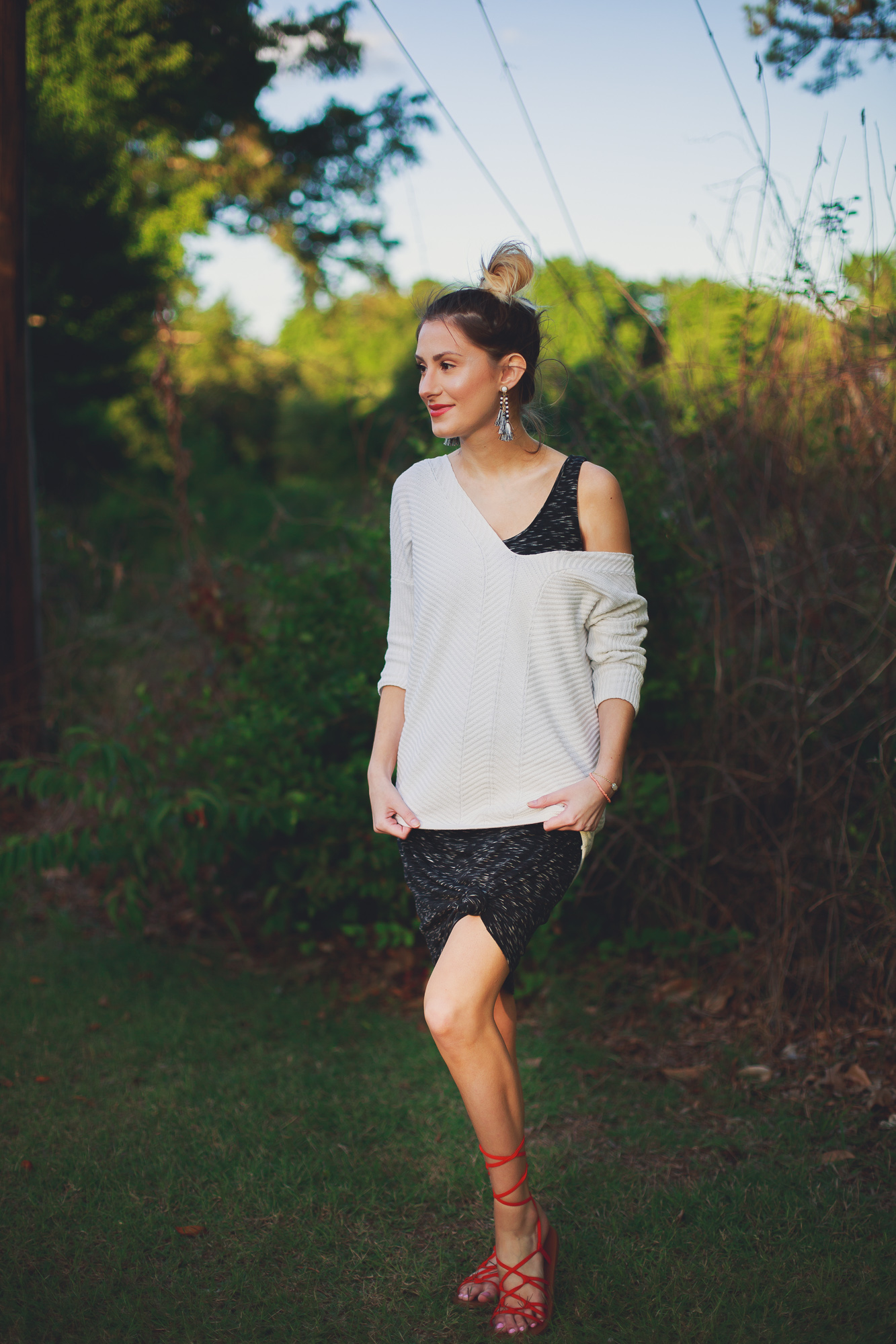 Life style, fashion, and beauty blogger / vlogger Jessica Linn  from Linn Style wearing Target maternity dress and Express sweater with Forever21 sandals and Baublebar earrings.