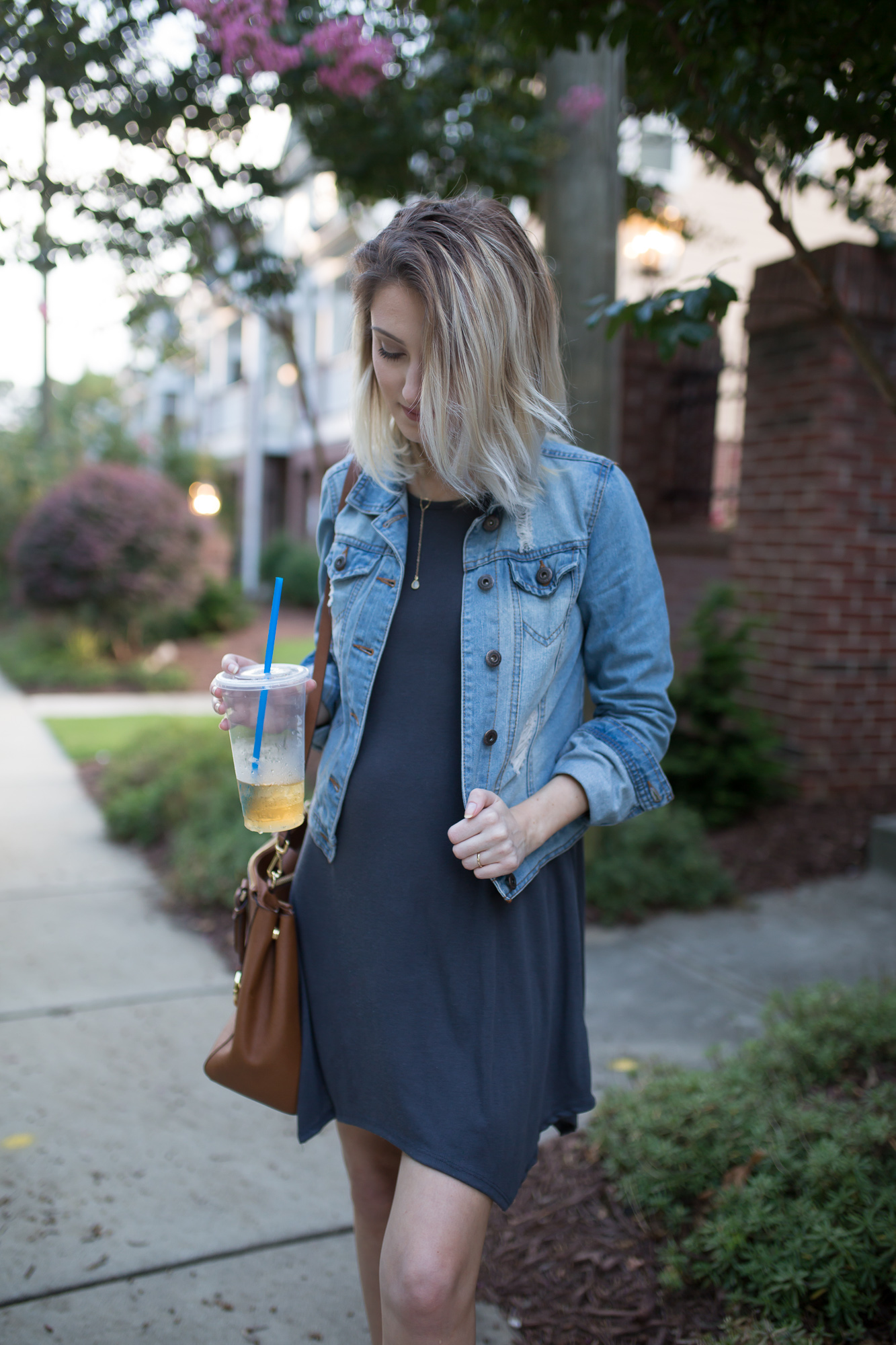 Lifestyle, fashion, and beauty blogger and vlogger Jessica Linn from Linn Style wearing a Forever21 t-shirt dress, and pair of blue shoes with embroidered florals and a denim jacket from Highway Jeans from Ross. Pregnant Maternity. and wearing a necklace from local Cary North Carolina business CY Design Studio.