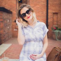Fashion, lifestyle, and beauty blogger/ vlogger Jessica Linn on Linn Style wearing a blue and white plaid button up t-shirt dress from Ross, lace up blue sandals from Report footwear, and jewelry from local Cary North Carolina business CY Design Studio and lipstick from locally made all natural organic lipstick from SumerReign Cosmetics by Ashley Summerville in Durham NC.