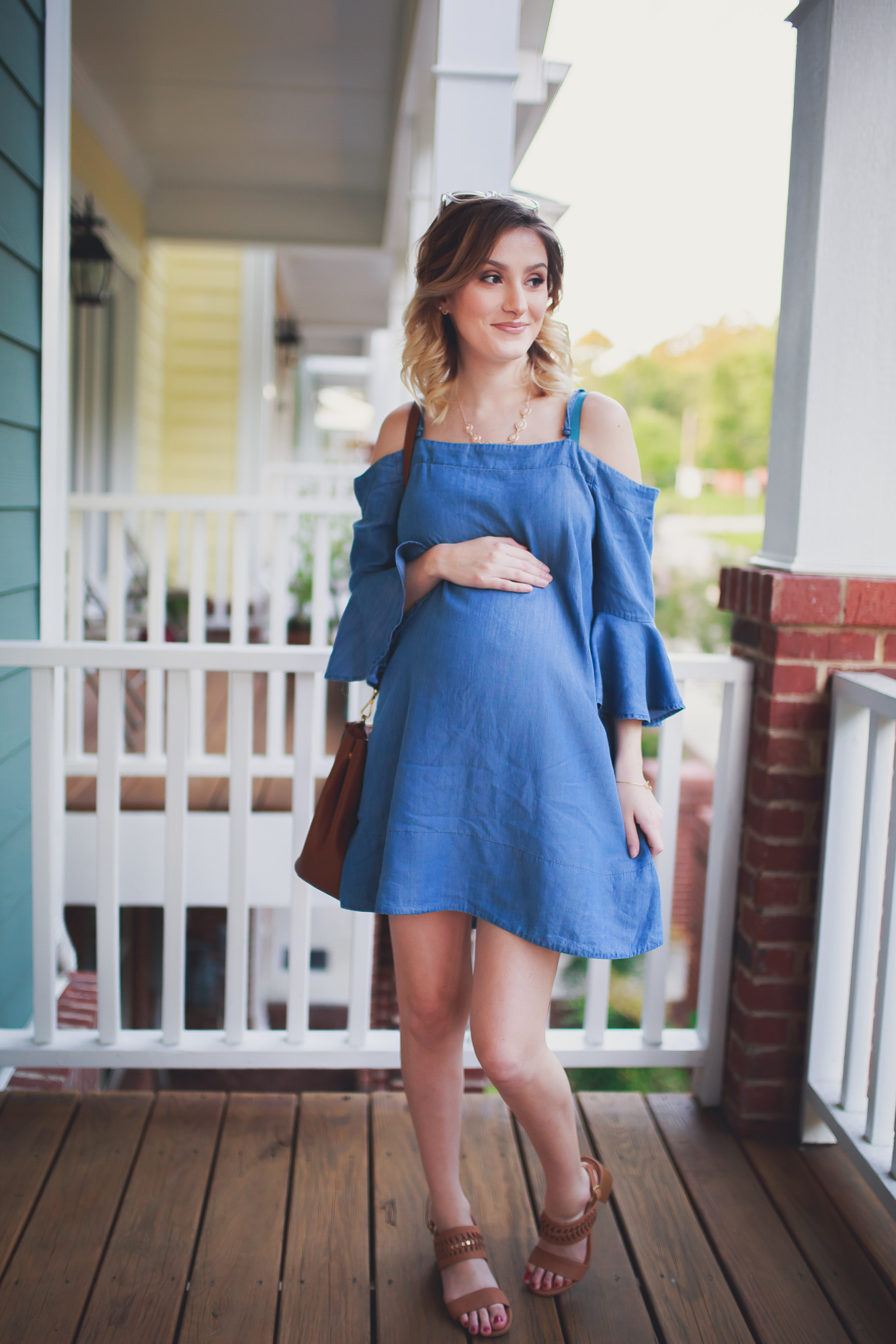 fashion, lifestyle, and beauty blogger and vlogger Jessica Linn from Linn Style wearing a chambray cold shoulder dress from Francesca's, brown heels from Matisse Footwear, a brown Michael Kors Bag, Necklace from Francesca's, and a bracelet from local North Carolina CY Design Studio. You don't have to wear only maternity clothes when you're pregnant. You can wear non-maternity maternity clothes!