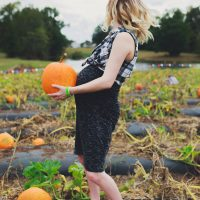 Lifestyle and fashion blogger Jessica Linn from Linn Style | Lifestyle post at Phillips farm in Cary North Carolina. Wearing a maternity dress from Target, flannel and Adidas. Fall Activities