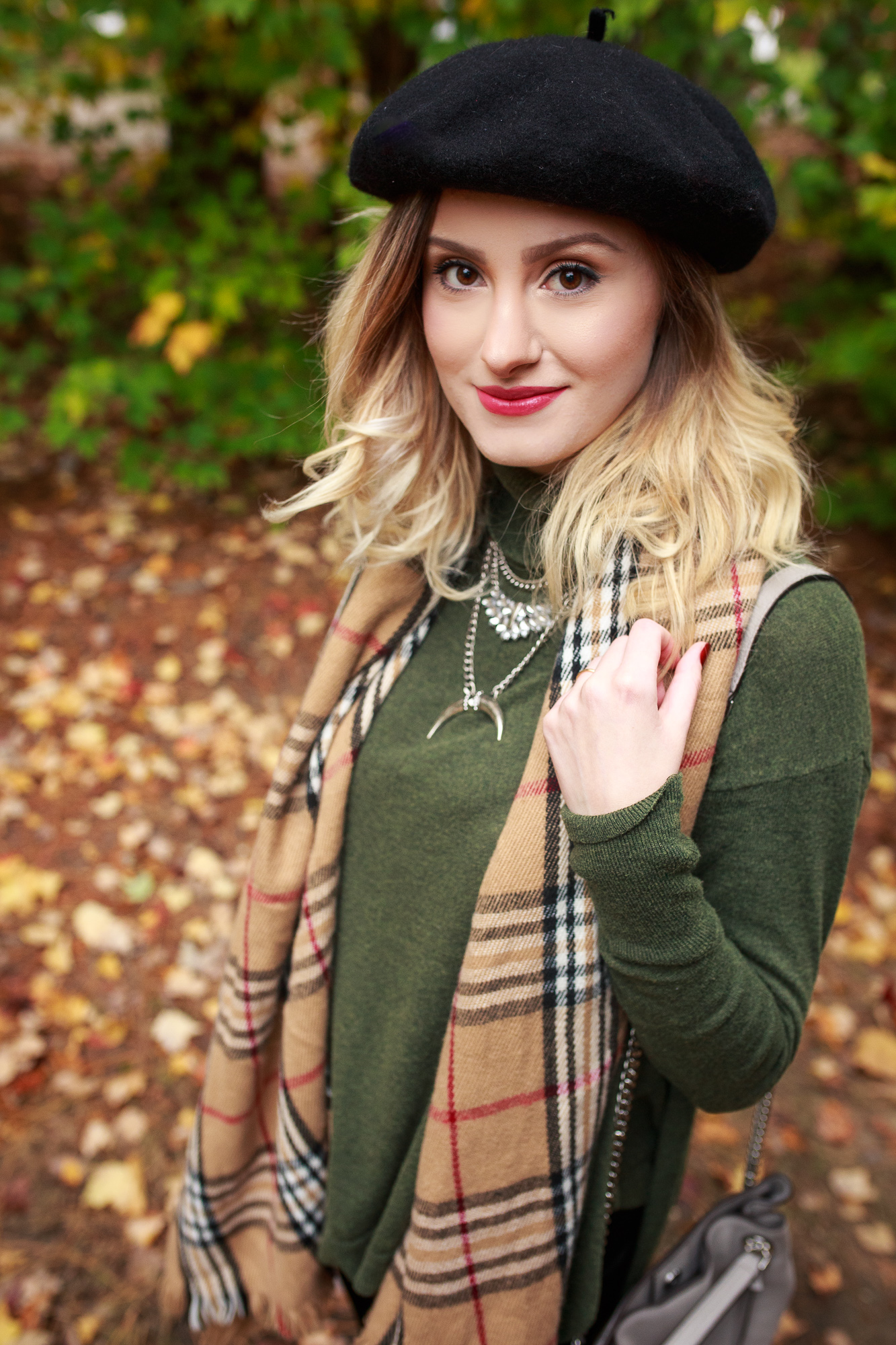Fashion and lifestyle blogger Jessica Linn from Linn Style wearing a Burberry style scarf, dark green sweater, black velvet leggings from A New Day from Target, a black beret, and over the knee boot from NineWest
