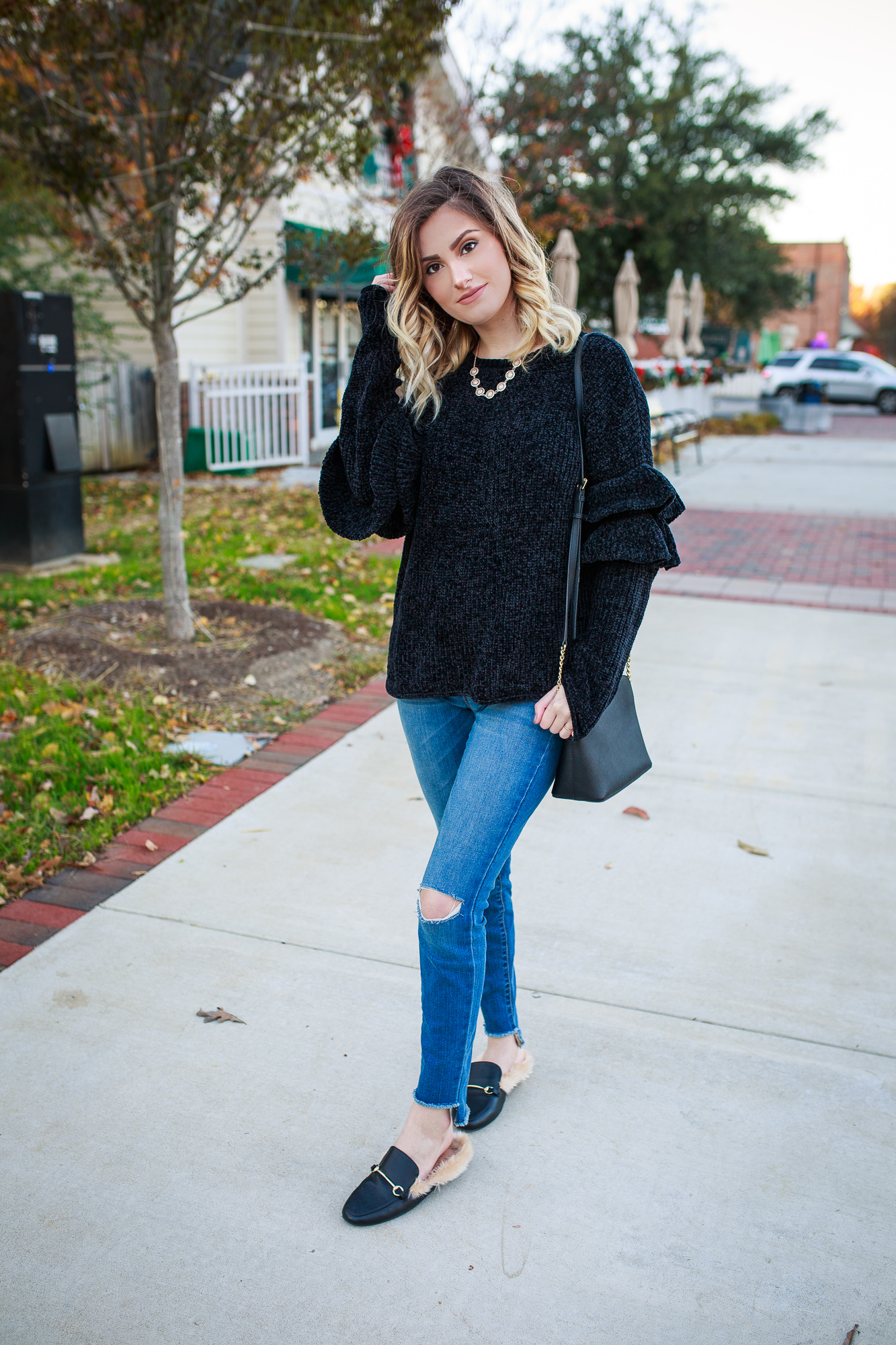 This entire look is from Target! This black chenille ruffle sleeves top is the softest sweater I own and cost me under $20. And wait until you see these Gucci dupes!