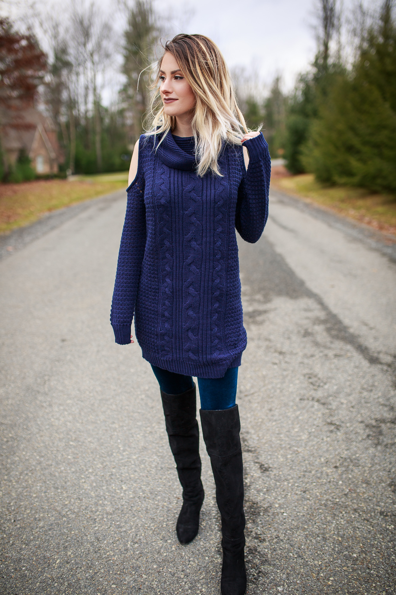 Ways to Wear A Loose Knit Sweater Dress: Velvet Leggings- Style inspiration by North Carolina lifestyle and fashion blogger Jessica Linn. Navy cold shoulder sweater dress from Francesca's layered over Forever21 blue velvet leggings with Nine West OTK Boots.