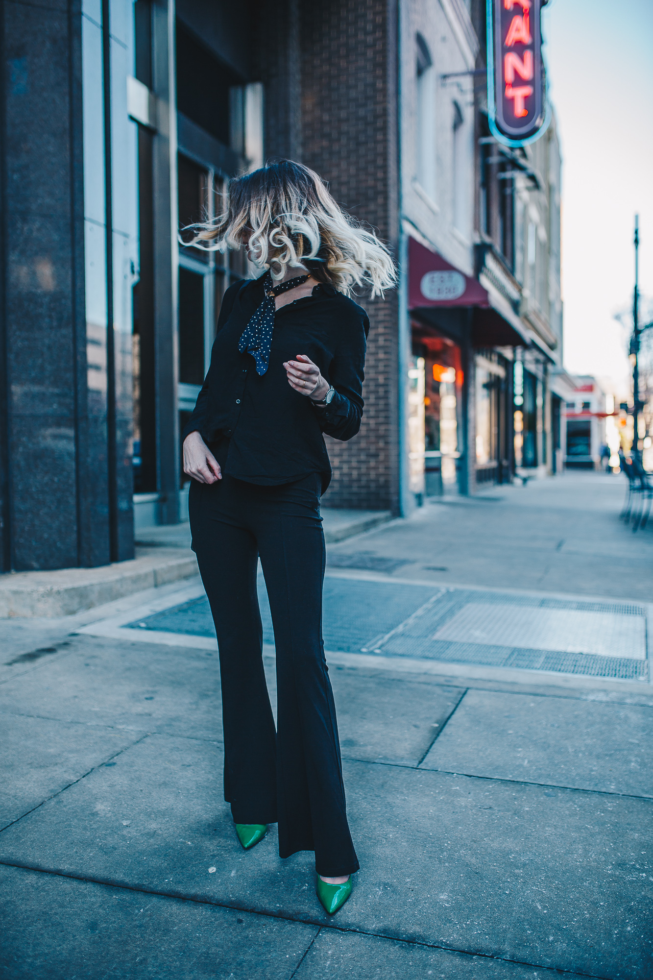 North Carolina fashion and lifestyle blogger Jessica Linn wearing a black button up blouse and black pintucked flare pants from Forever21, a neckerchief from Romwe, sunglasses from Francescas, thrifted green pointy toe heels, and a Welly Merck watch.
