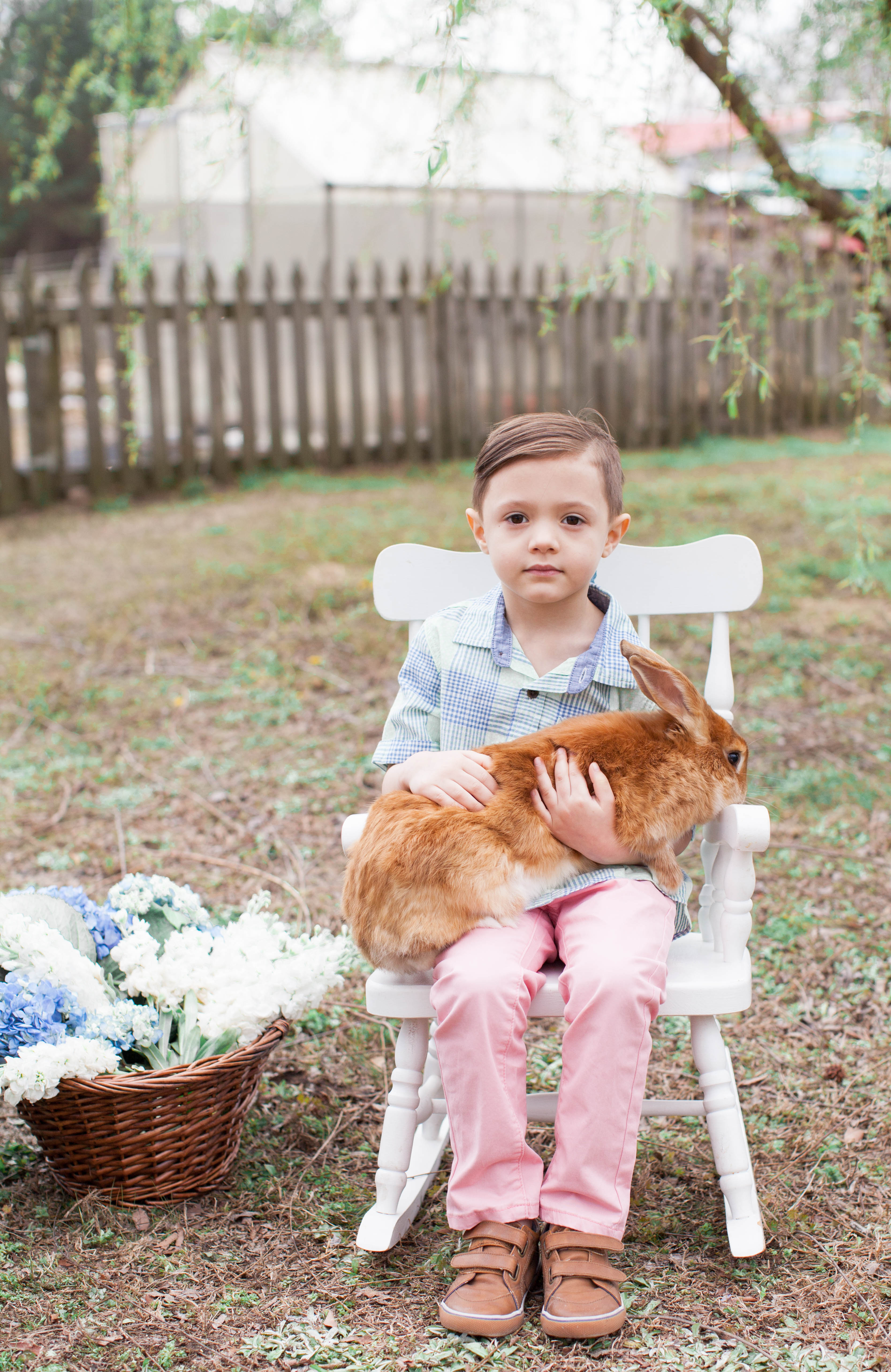North Carolina fashion and lifestyle blogger and writer Jessica Linn in Valentine Fields Farm in Knightdale NC. Spring and Easter family photography by Hayley Gastiger a local North Carolina photographer. Spring childrens photo with bunny.