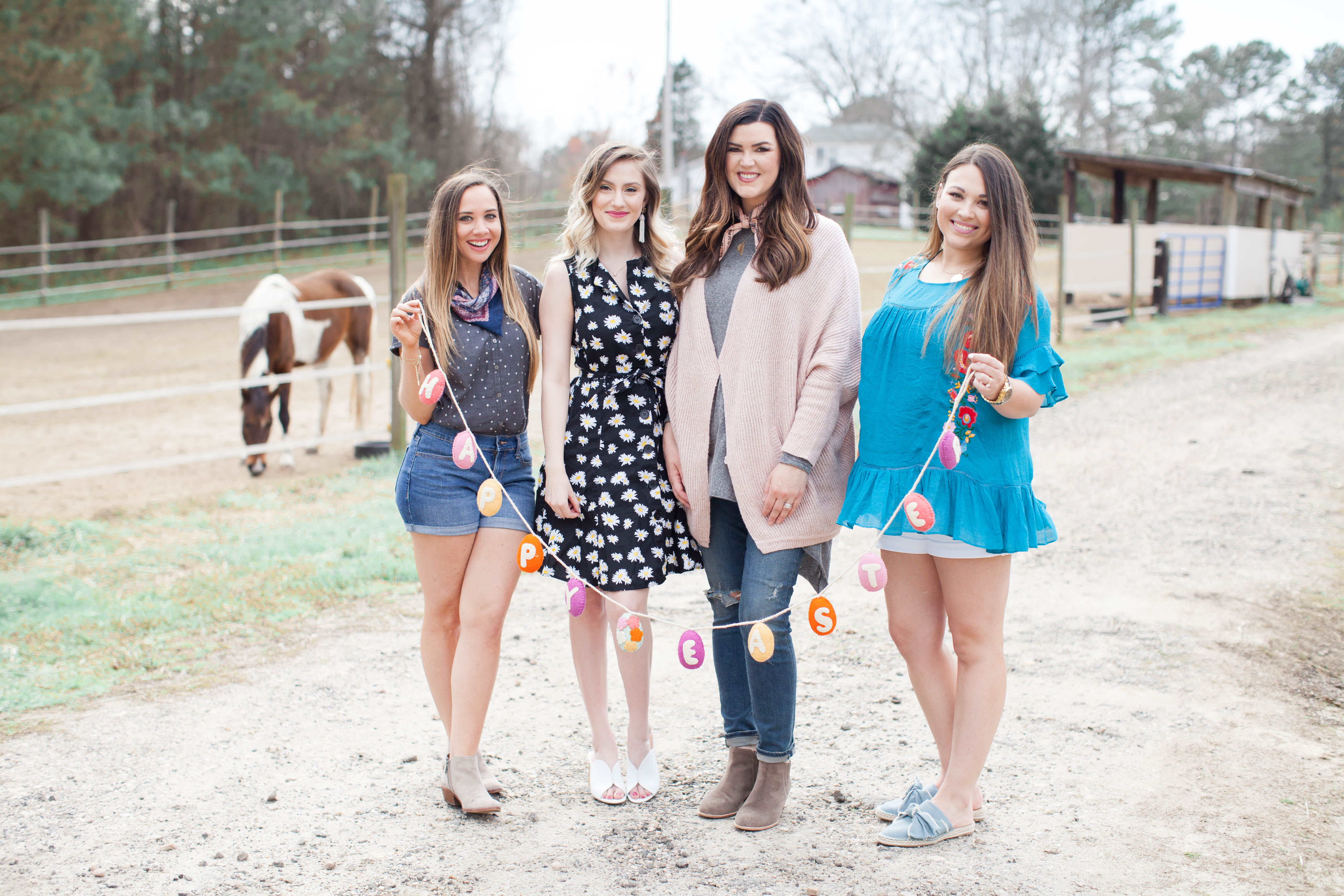 North Carolina fashion and lifestyle bloggers Courtney from Courtney Fashionista, Jessica Linn from Linn Style, Lindsey from Baubles and Backdrops, and Stephanie from A Style of Her Own. Photography by Hayley Gastiger at Valentine Fields Farm in Knightdale NC.