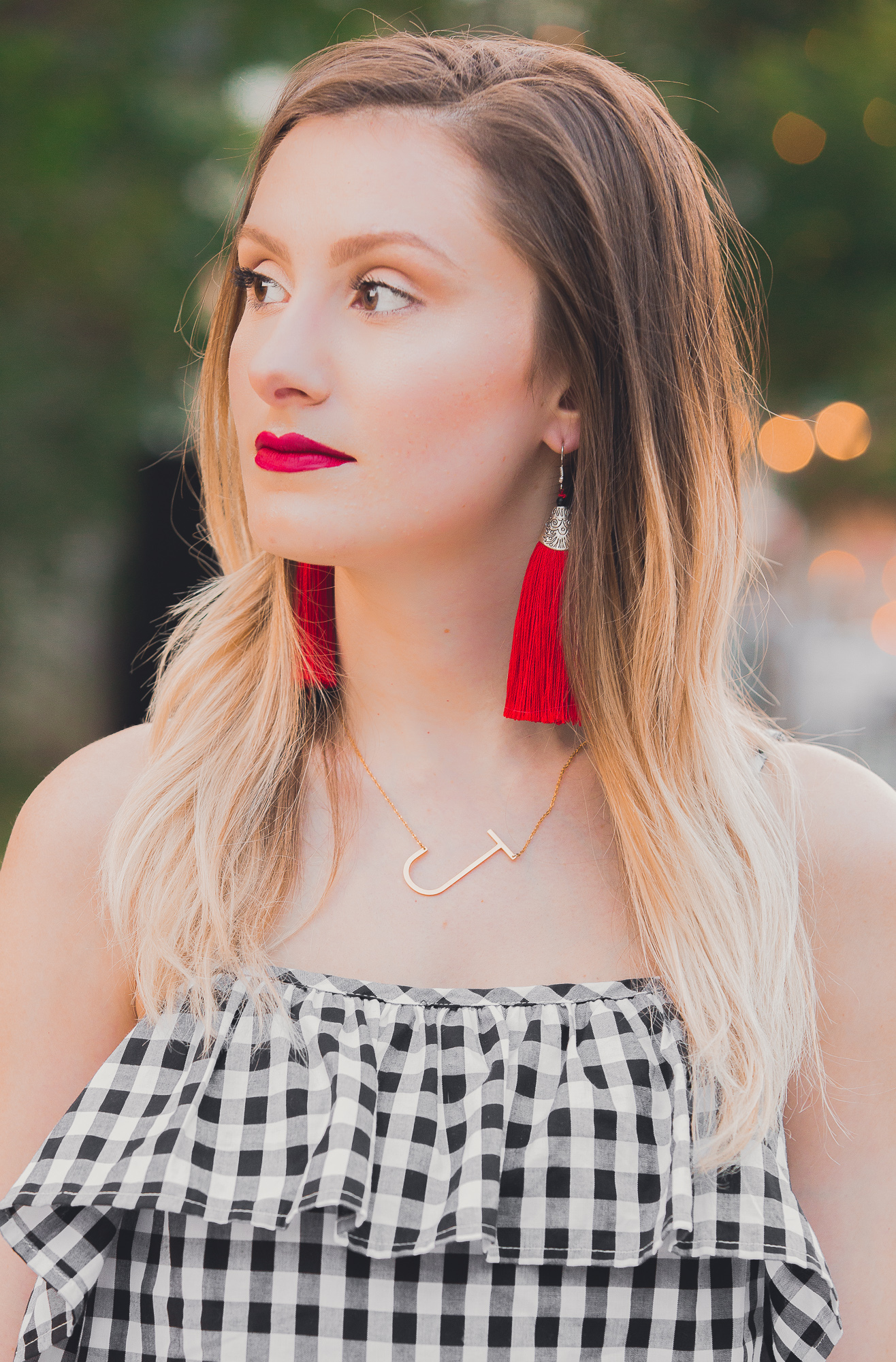 Gingham ruffle cami from Target, white denim, an da pop of red heels and earrings. Affordable summer fashion by popular North Carolina fashion blogger Jessica Linn from Linn style.