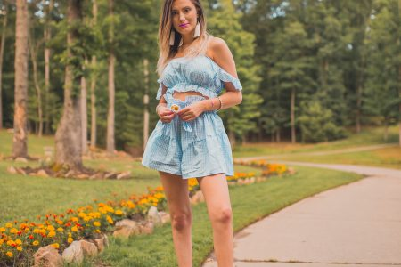Gingham summer trend styled by North Carolina fashion and lifestyle blogger Jessica Linn from Linn Style. Two piece shorts and crop top gingham set from online fashion boutique Copper Bloom, platform sandals from Target, and tassel statement earrings from Copper Bloom.