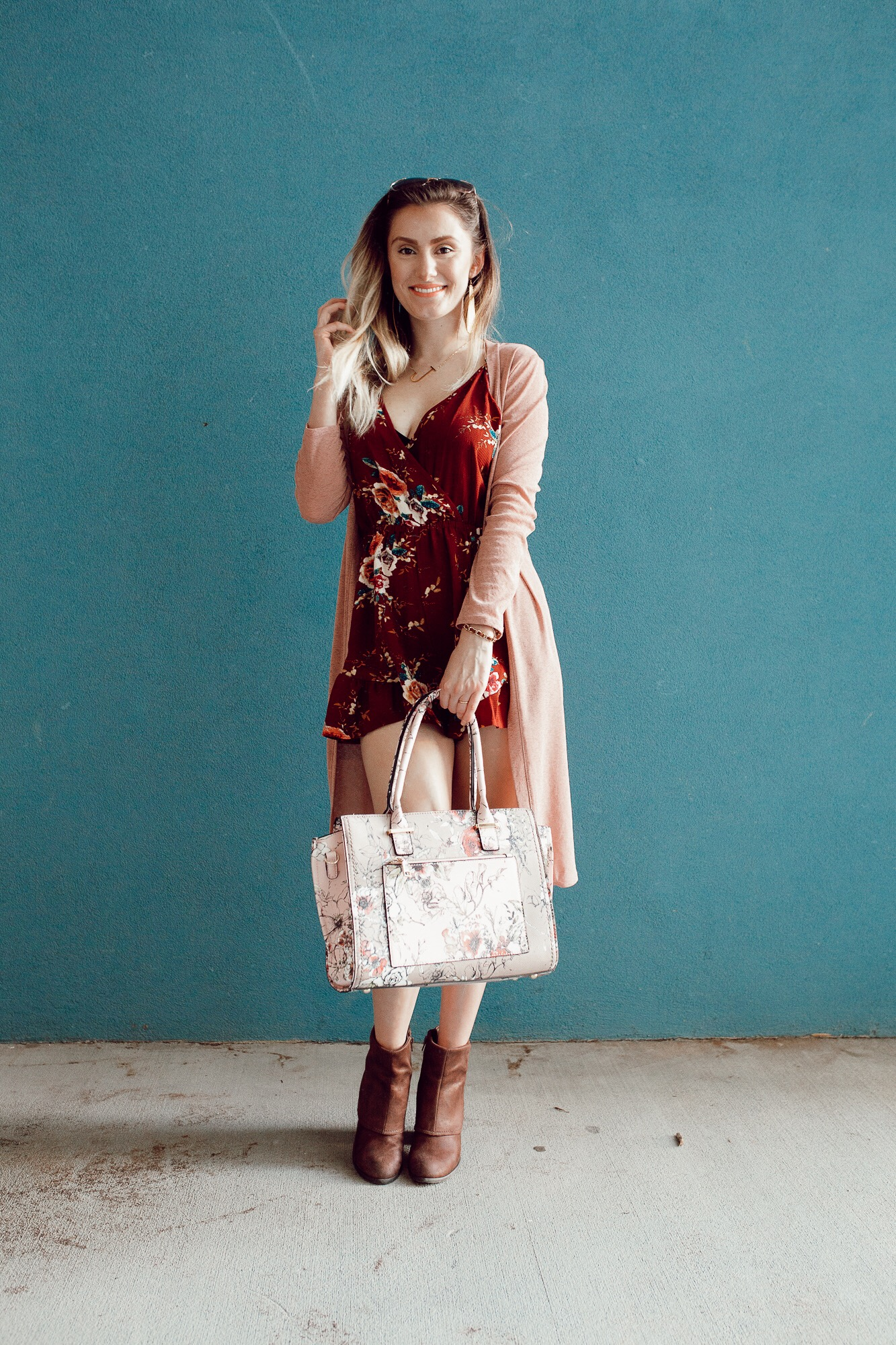 Summer to fall transition outfit by popular North Carolina fashion blogger Jessica Linn. Burgundy floral print romper from Copper Bloom, pink duster cardigan from Romwe, boots from Fergalicious by Fergie.