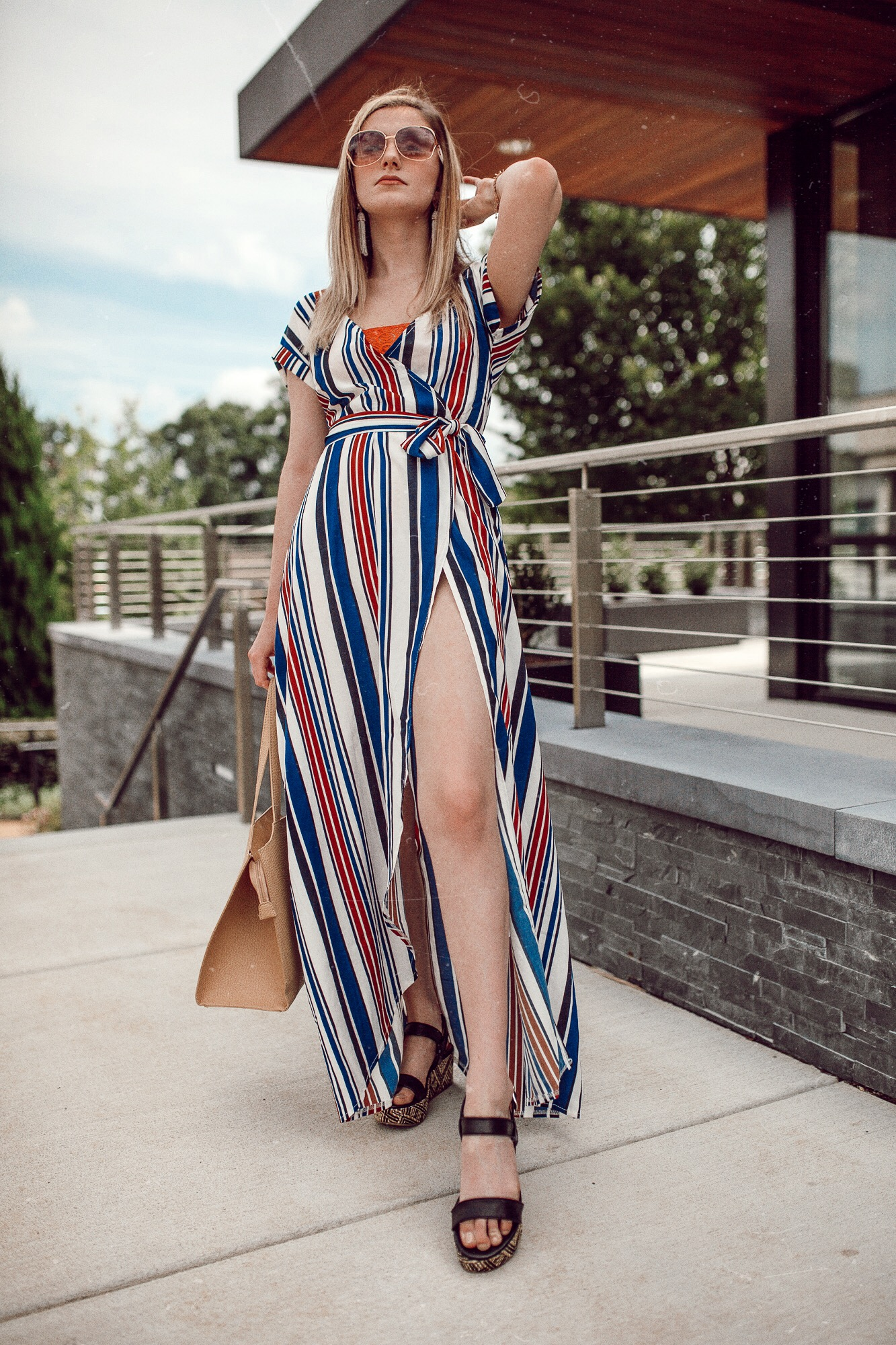 North Carolina fashion and lifestyle blogger Jessica Linn wearing a striped maxi wrap dress from Sugarhigh clothing, and platform sandals from Target.