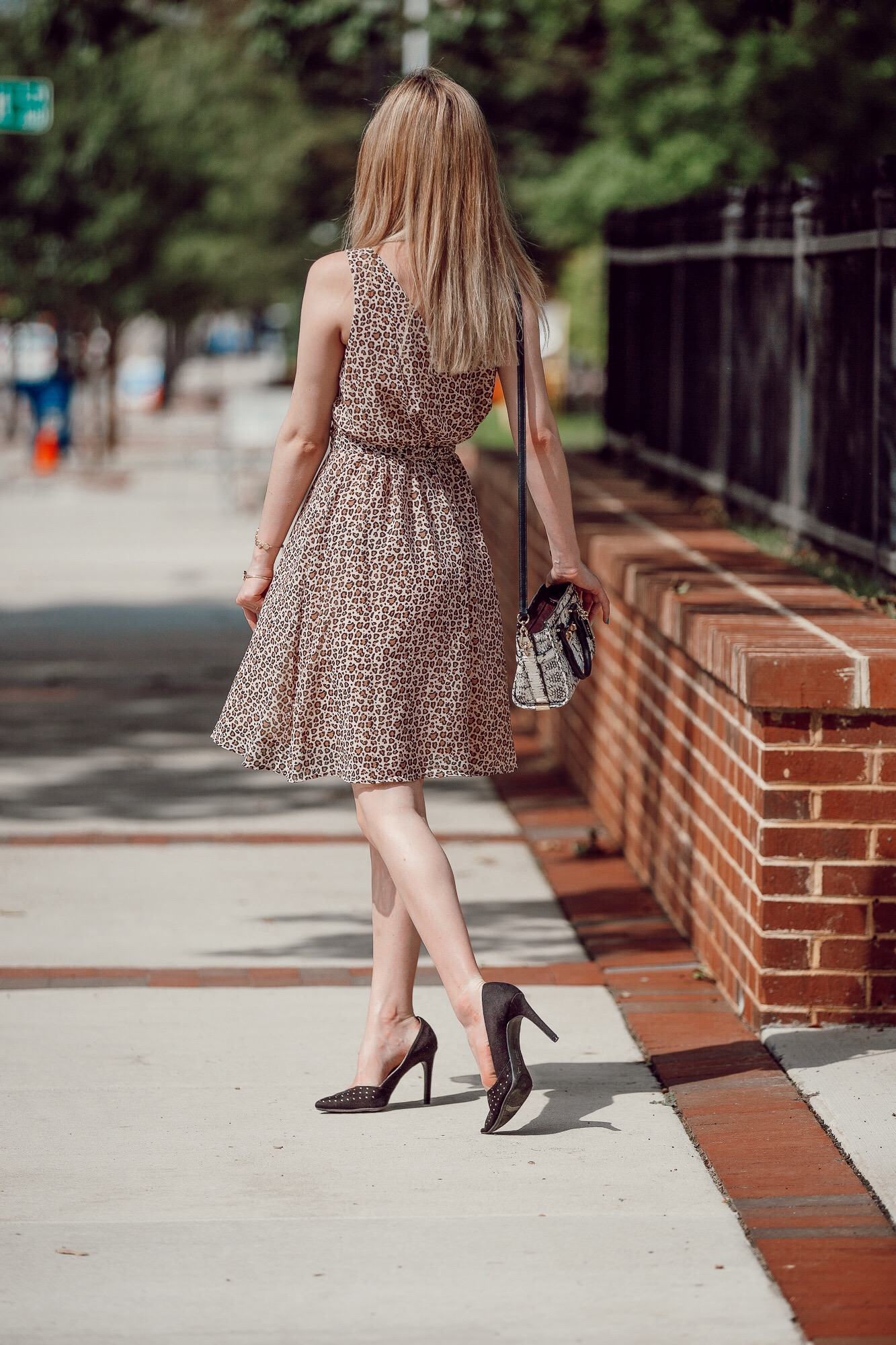 How To Style Leopard Print |Affordable leopard print midi sleeveless dress from Target, black studded heels by Christian Siriano for Payless, and a black and white snake skin purse from Coach. Fashion inspiration by North Carolina fashion and lifestyle blogger Jessica Linn from Linn Style