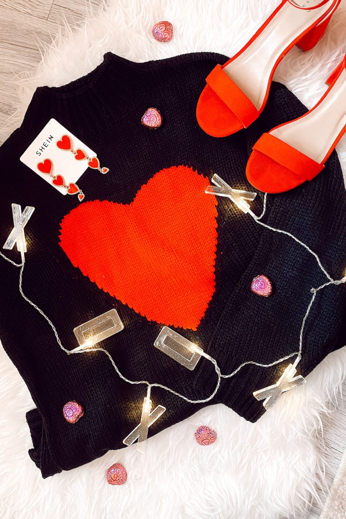 Heart Themed Outfits & Accessories For Valentine's Day By Jessica Linn owner of Linn Style Black and red heart sweater, red heart earrings, red heels.