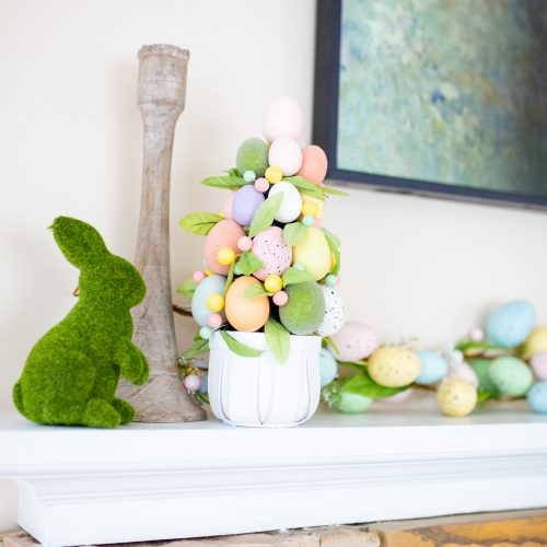 Simple easter mantle decorations. Easter topiary and grass bunny from Target.