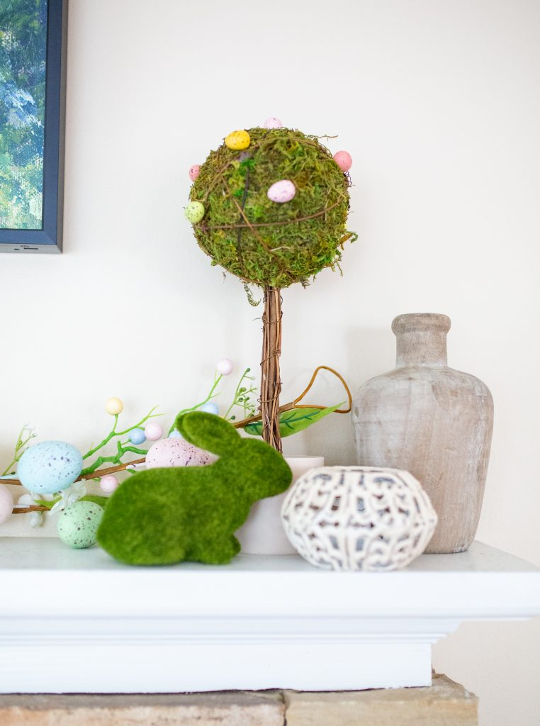 Simple Easter mantle decorations. Easter egg garland, egg topiaries