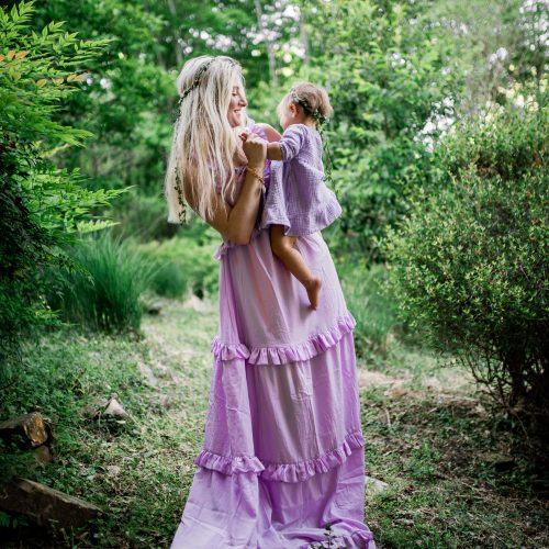 What To Get A One Year Old Baby Girl For Their First Birthday | Baby Gifts by Jessica Linn | Mom and baby daughter wearing purple dress and flower crowns